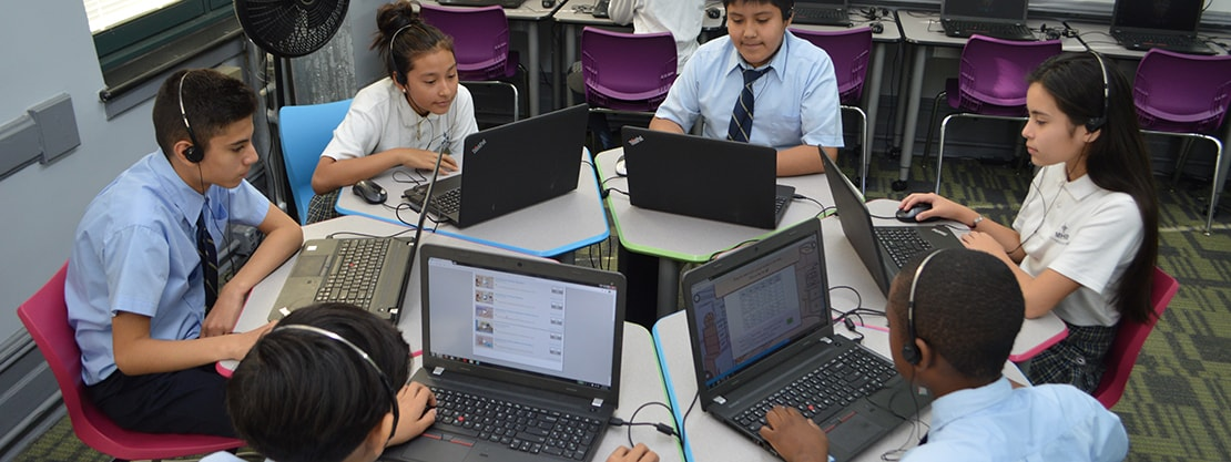 students working with laptop computers