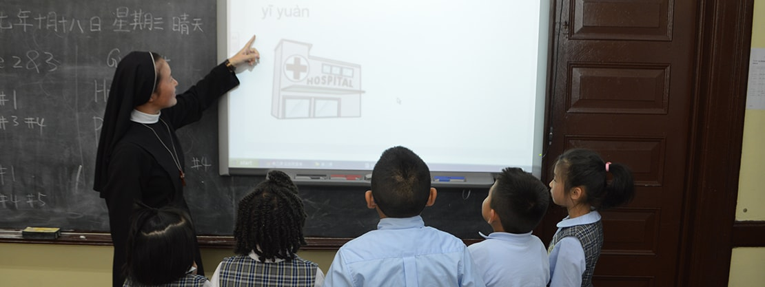 teacher instructing students with SmartBoard