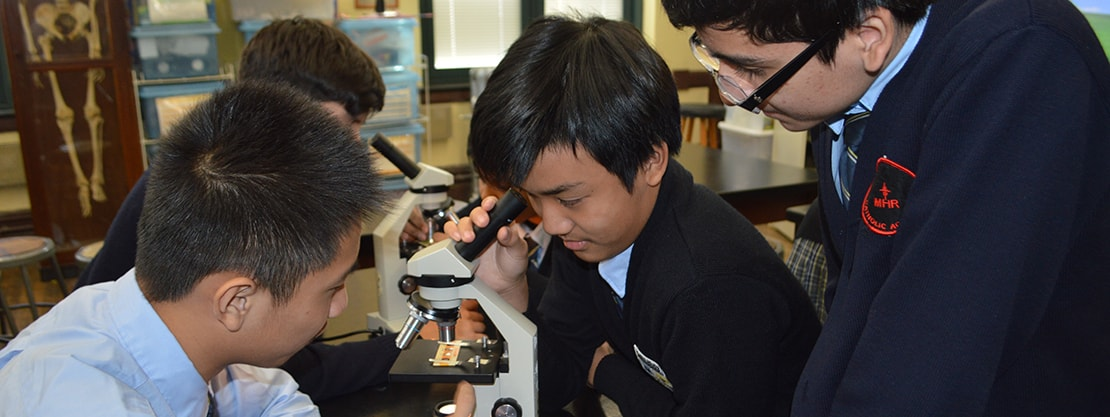 student working with microscope