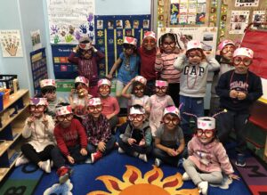 PreK students wearing valentines hats