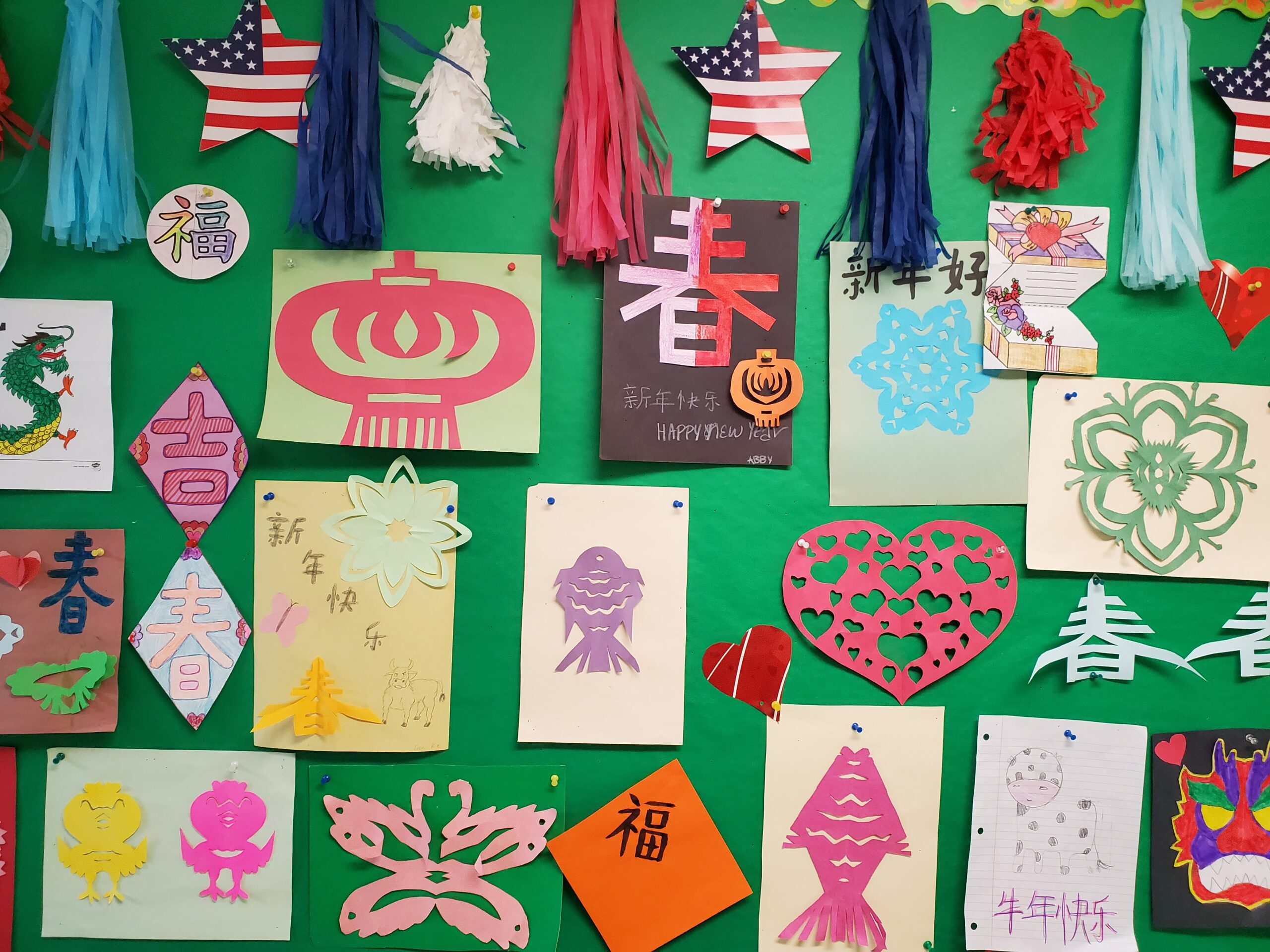Bulletin board covered with Lunar New Year art projects