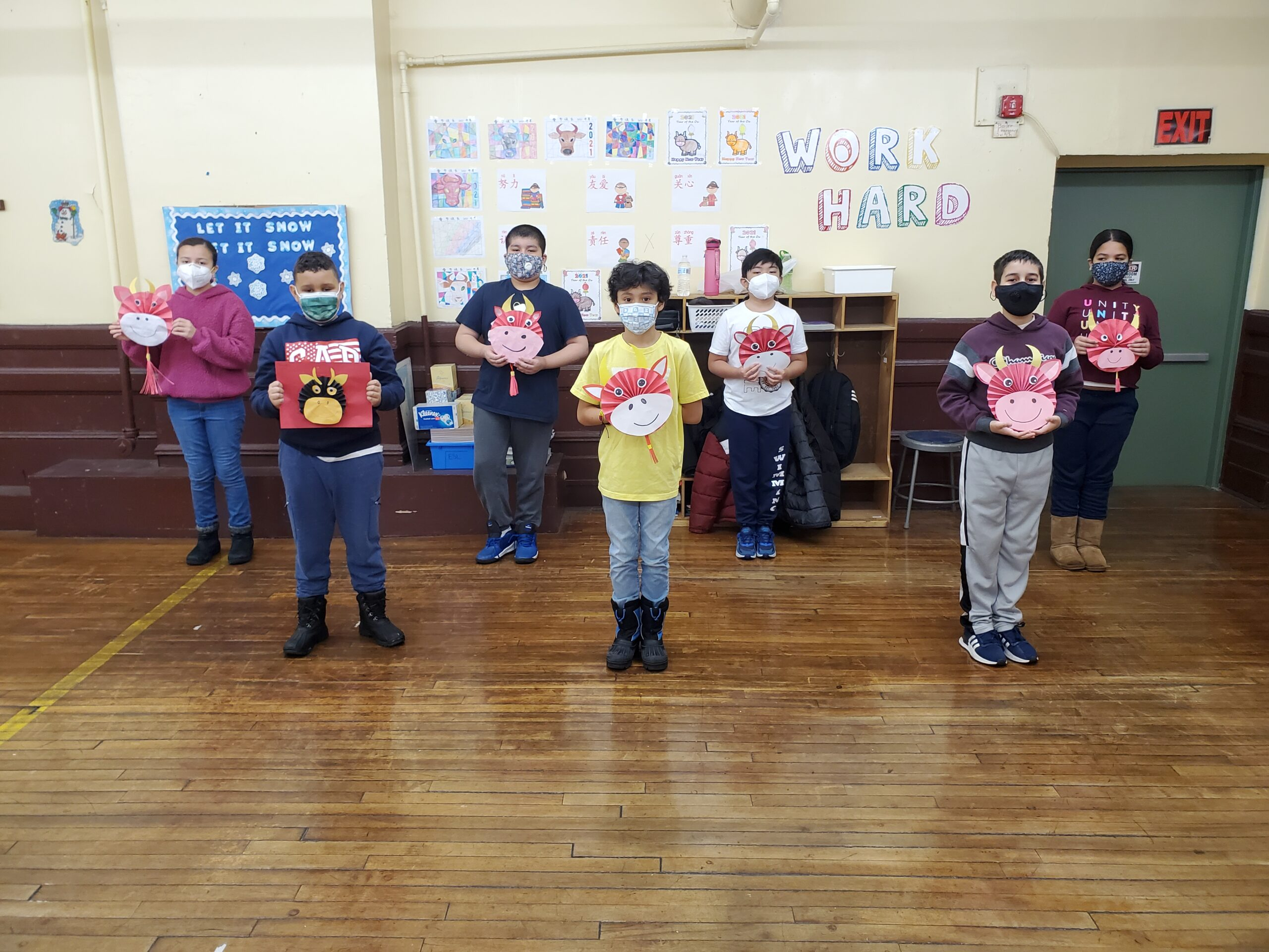 Grade 5 Students displaying their Ox masks