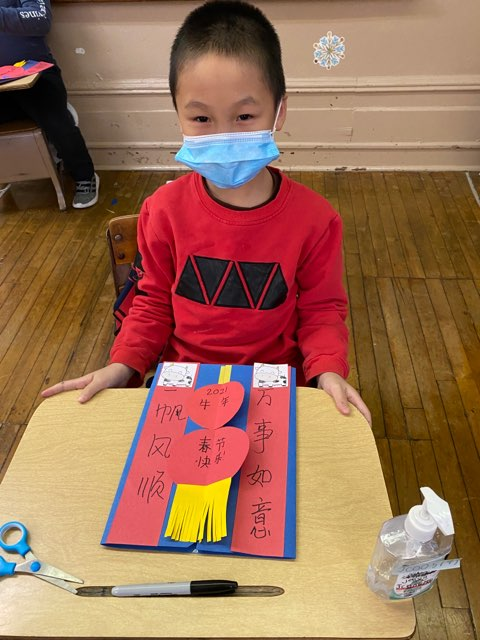 Grade 2 student displaying art project