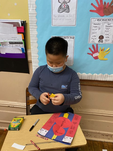 Grade 2 student working on art project