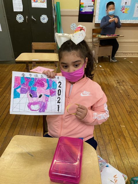 Grade 2 student holding Coloring page