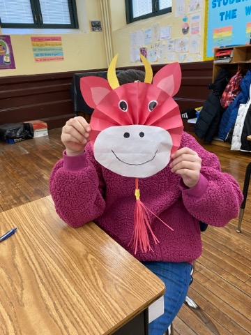 Grade 5 student wearing ox mask