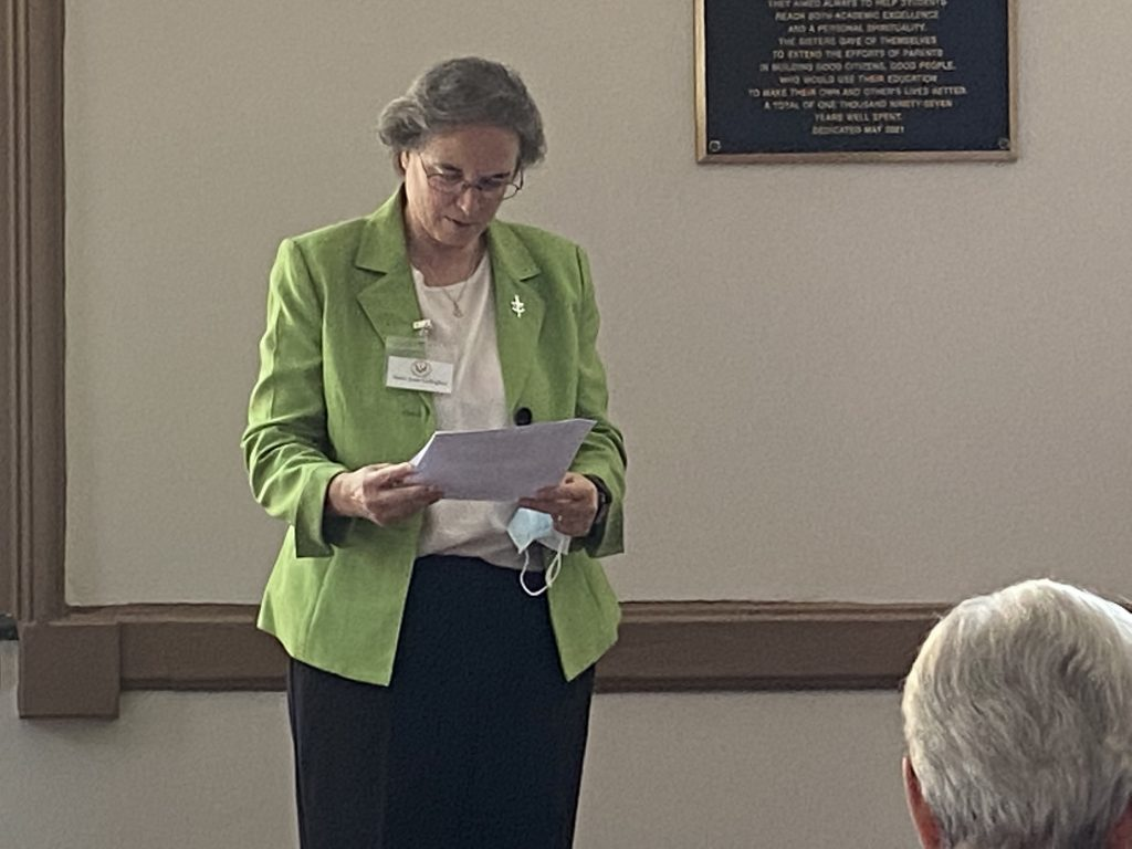 Sister Joan Gallagher speaks at ceremony